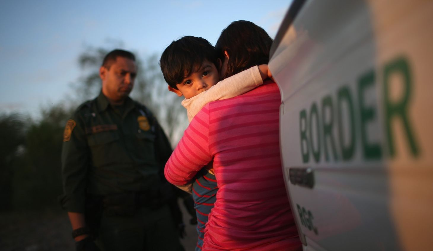 A one-year-old from El Salvador clings to his mother after she turned themselves in to Border Patrol agents on Dec. 7, 2015 near Rio Grande City, Texas. They had just illegally crossed the U.S.-Mexico border into Texas. (John Moore/Getty Images)