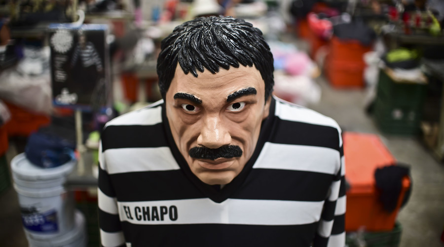 """A costume and a mask representing Mexican drug trafficker Joaquin Guzman Loera, aka """"El Chapo"""", are pictured in a factory of costumes and masks, on October 16, 2015, in Jiutepec, Morelos State. © Ronaldo Schemidt / AFP"""