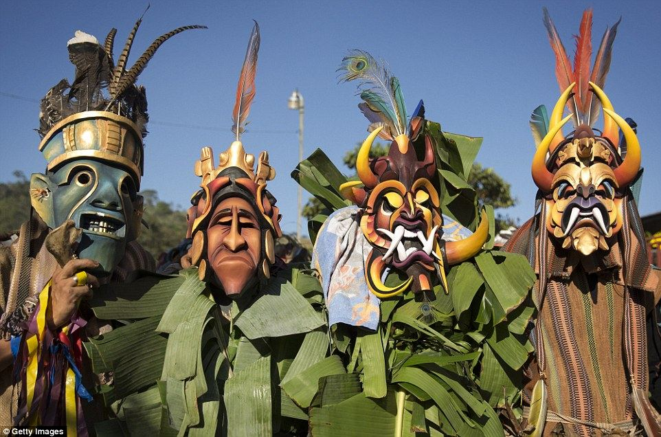 Bruca men wearing masks chase a 'bull' through the streets as part of the El Juego de los Diablitos (Dance of the Little Devils) festival Read more: http://www.dailymail.co.uk/travel/travel_news/article-3382683/Costa-Rica-s-Boruca-tribe-enacts-resistance-against-Spanish-conquerors.html#ixzz3wHxb3voI Follow us: @MailOnline on Twitter | DailyMail on Facebook