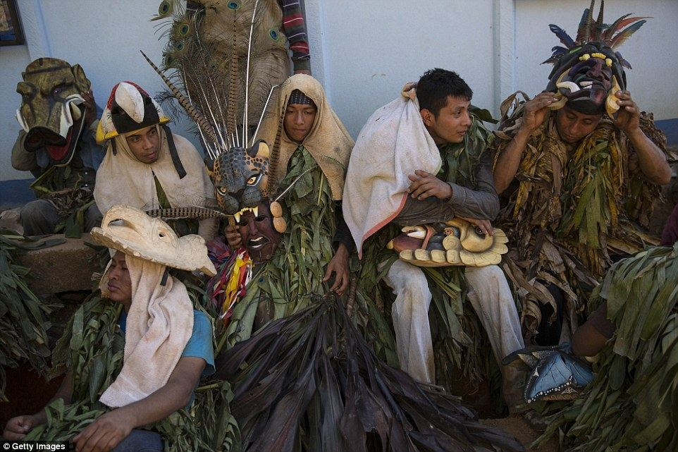 Boruca men wearing carved masks relax during festivities. The festival is held over four days and coincides with the start of the new year Read more: http://www.dailymail.co.uk/travel/travel_news/article-3382683/Costa-Rica-s-Boruca-tribe-enacts-resistance-against-Spanish-conquerors.html#ixzz3wHxu7Rl5 Follow us: @MailOnline on Twitter | DailyMail on Facebook