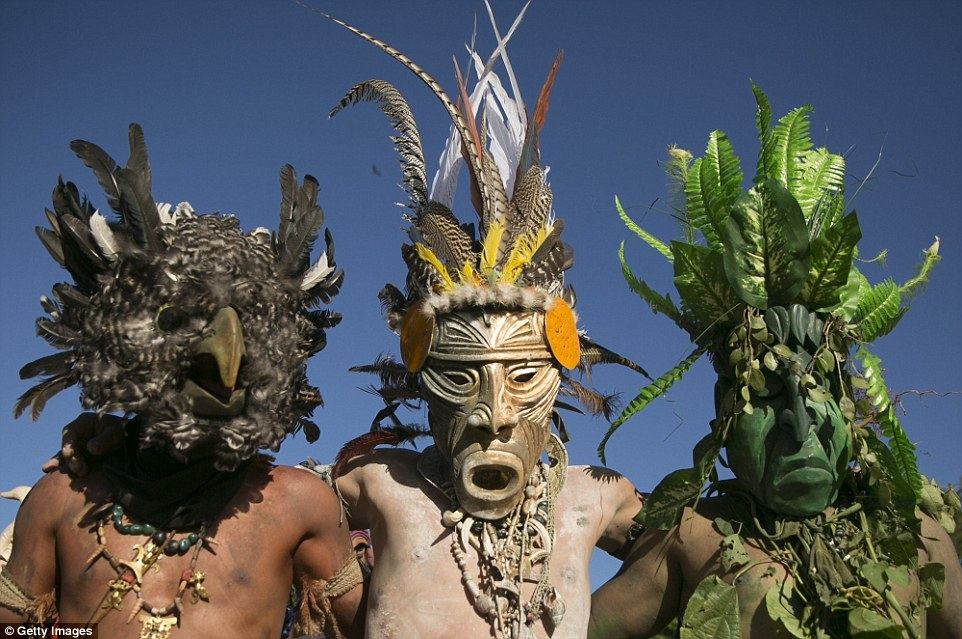 The masked tribesmen represent the 'little devils' while the man wearing the bull costume represents the Spanish conquerors Read more: http://www.dailymail.co.uk/travel/travel_news/article-3382683/Costa-Rica-s-Boruca-tribe-enacts-resistance-against-Spanish-conquerors.html#ixzz3wHxhzirq Follow us: @MailOnline on Twitter | DailyMail on Facebook