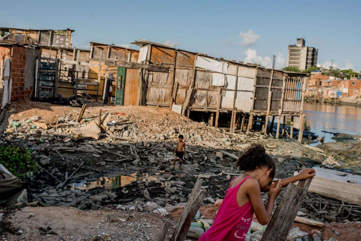 Children play in the neighborhood of Coelho. Standing water—and the mosquitoes that breed there—are nearly impossible to eliminate in conditions like these.