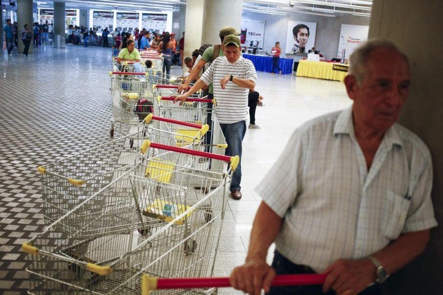 Customers line up to enter a state-run Bicentenario supermarket in Caracas, Venezuela. (Jorge Silva/Reuters)