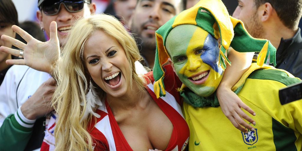 Fans of Paraguay and Brazil pose for pictures before the start of their 2011 Copa America quarter-final football match held at the Ciudad de La Plata stadium in La Plata, 59 Km south of Buenos Aires, on July 17, 2011. AFP PHOTO / DANIEL GARCIA (Photo credit should read DANIEL GARCIA/AFP/Getty Images)