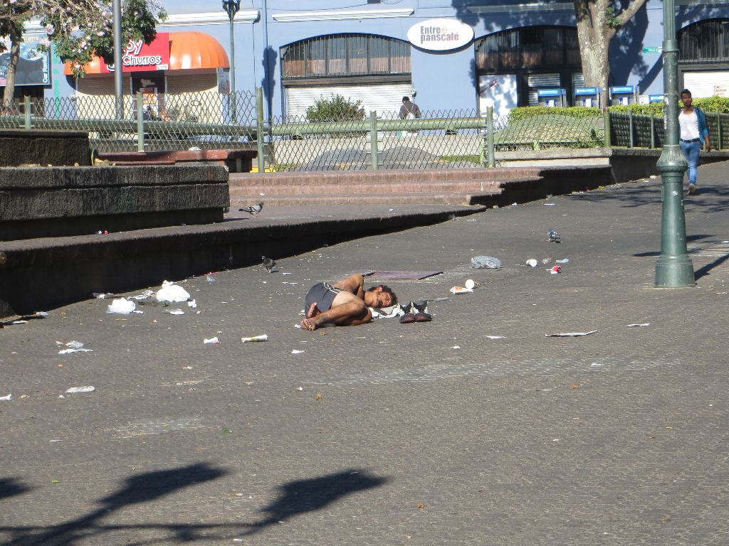 One of San José's homeless men takes advantage of Holy Week by sleeping unmolested in the middle of Avenida Central at the Plaza de la Cultura. Normally at 7:30 in the morning, this pedestrian walkway would be packed with tens of thousands of Ticos hurrying to work.