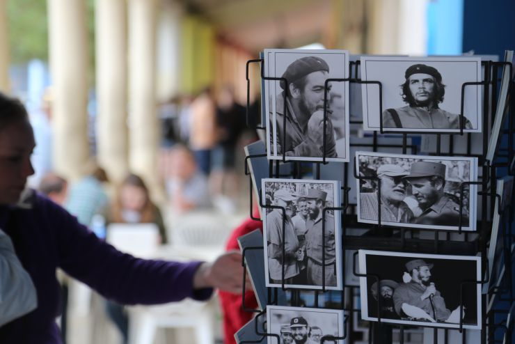 An American tourist looks at revolutionary postcards for sale in Viñales, Cuba
