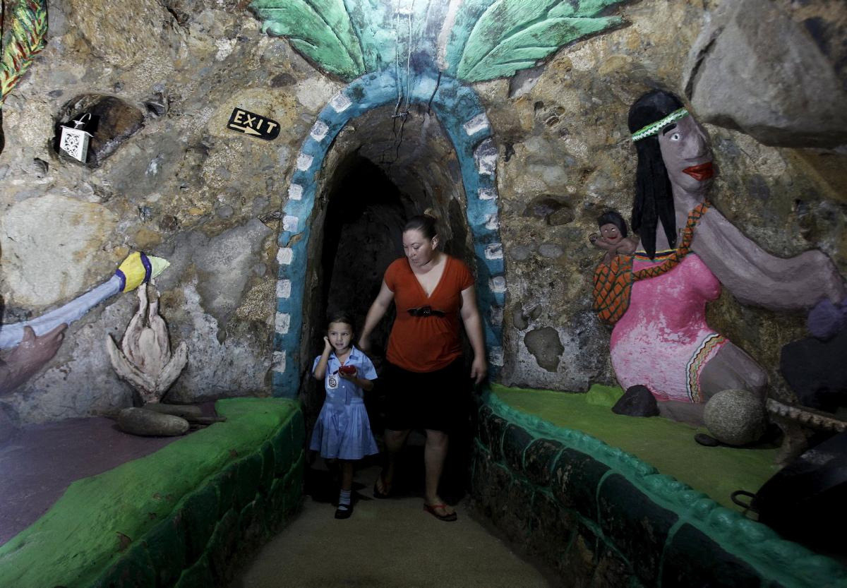 Lidieth Barrantes and her daughter walk in a hallway of a house built underground by Manuel Barrantes in San Isidro de Perez Zeledon, Costa Rica, March 14, 2016. Photo Juan Carlos Ulate/Reuters