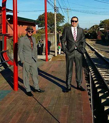 The mayor of Alajuela, Roberto Thompson (right) stands with with Fabián González, by the tracks in his city that will some day see train service. Photo from Facebook.
