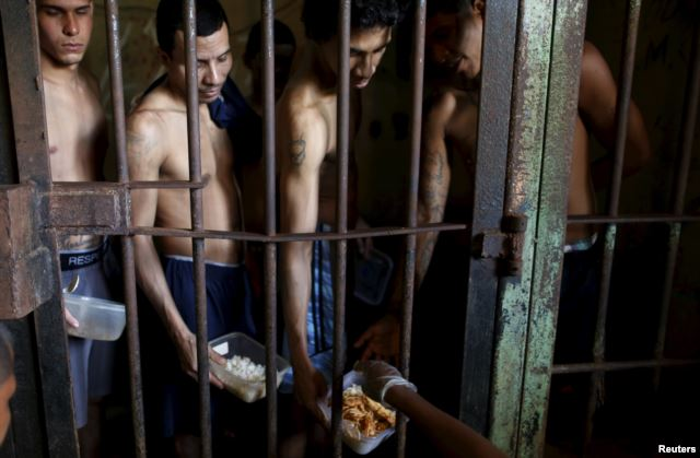 Inmates line up for food provided by the prison in Pavilion No.2 in La Joya prison on the outskirts of Panama City, Panama
