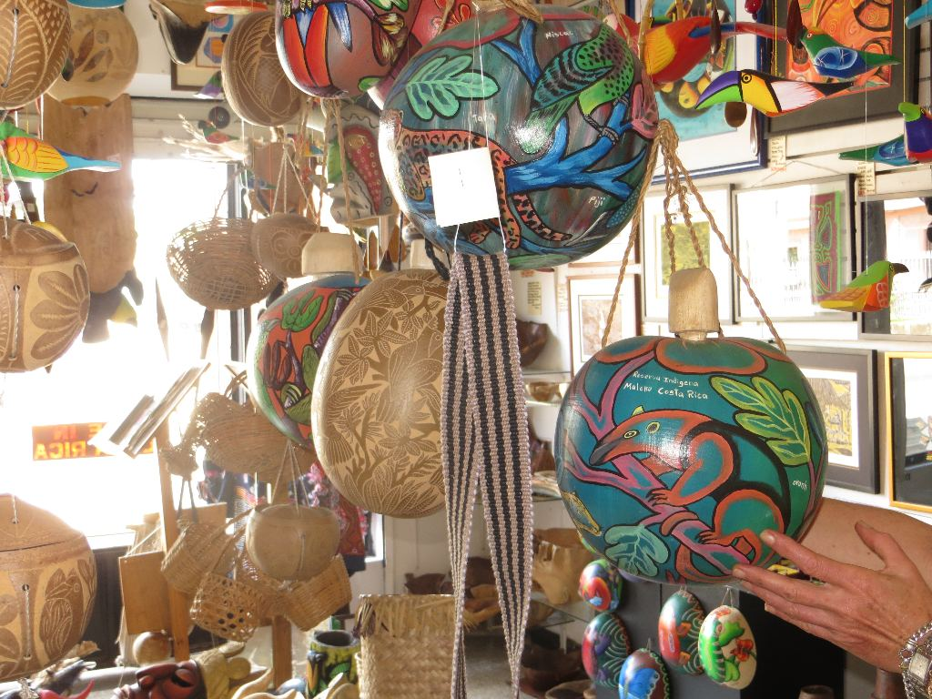 These decorative globes are made from the Jicaras, a fruit similar to a gourd. They are painted or etched and used for carrying water.