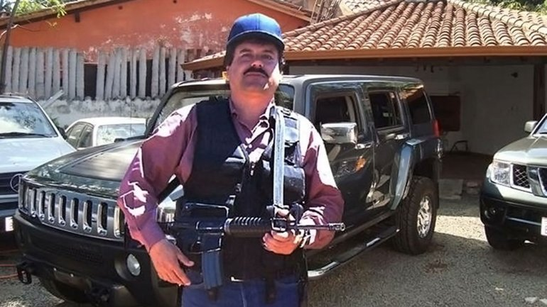 "El Chapo ""Guzman with a rifle in hand. Photo credit: USDOJ - Rolling Stone"