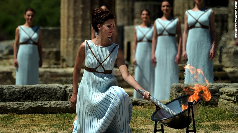 Rio 2016: Olympic torch lit The Olympic flame is back: Greek actress Katerina Lechou performs the role of the high priestess as she lights the Olympic flame at the Temple of Hera at the site of ancient Olympia.