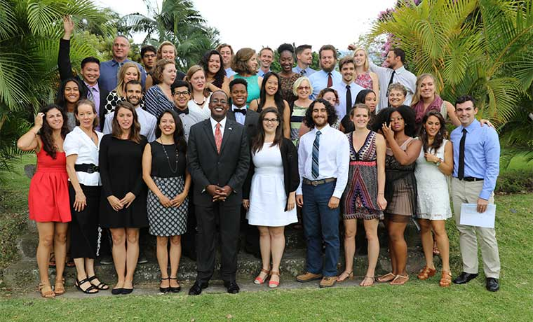 U.S. Ambassador to Costa Rica, , stands with the last group of Peace Corps volunteers
