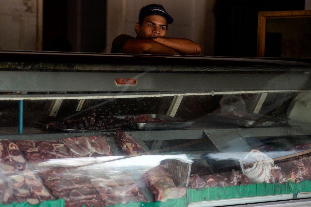 An employee of a butcher shop waits during a power cut in Santa Teresa, Venezuela on April 25, 2016 An employee of a butcher shop waits during a power cut in Santa Teresa, Venezuela on April 25, 2016 (AFP Photo/Federico Parra)