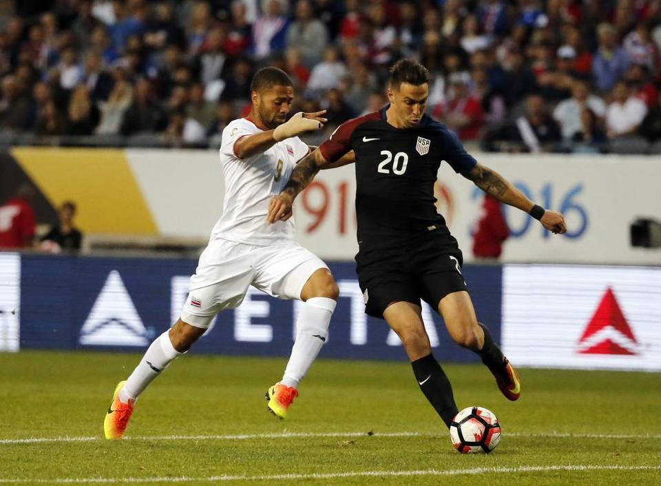 United States' Geoff Cameron (20) and Costa Rica's Alvaro Saborio (9) battle during a Copa America Centenario group A soccer match at Soldier Field, Tuesday, June 7, 2016 in Chicago. The United States won 4-0.
