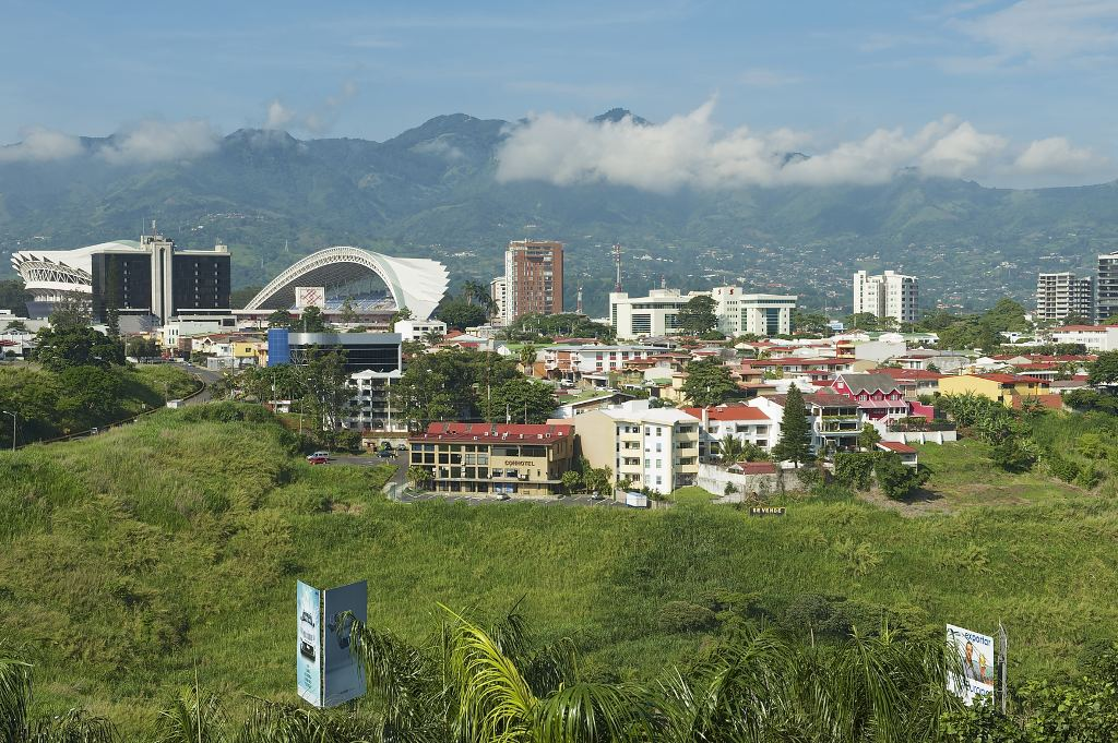 SAN JOSE, COSTA RICA - JUNE 18, 2012: View to the National Stadium and buildings with mountains at the background in San Jose, Costa Rica.