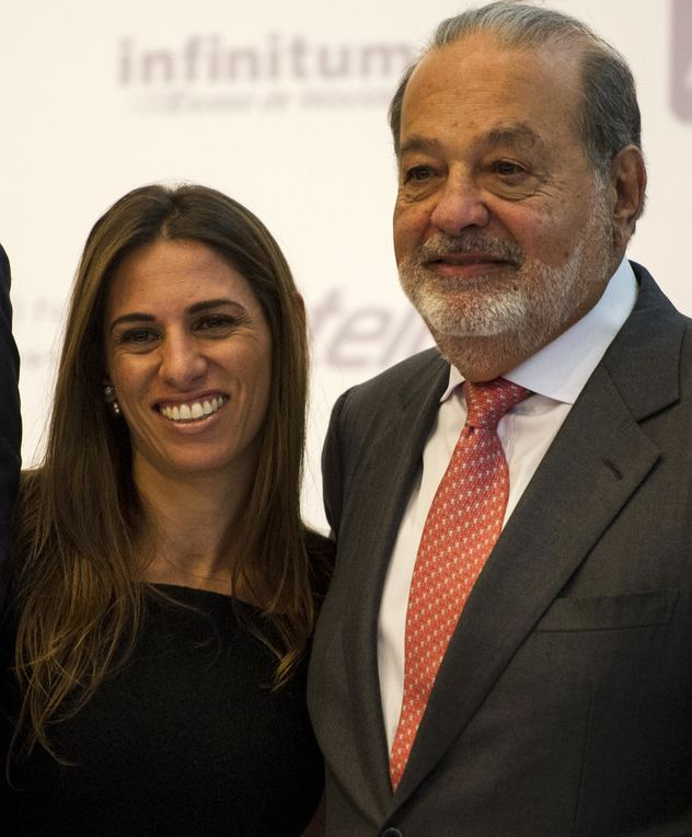 Mexican billionaire Carlos Slim poses for a photo with his daughter, Johanna, after speaking about a new educational application during a news conference at the Museo Soumaya in Mexico City, Wednesday, June 15, 2016. The application, titled Aprende, is free and is currently used around the world.
