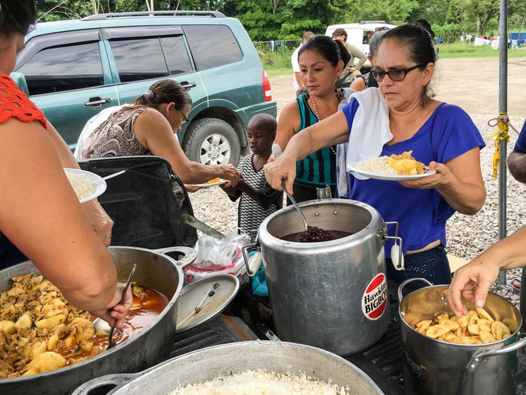 A team of volunteers cooks for African migrants living at a camp in their town of Paso Canoas, Costa Rica. Photo Rolando Arrieta /NPR
