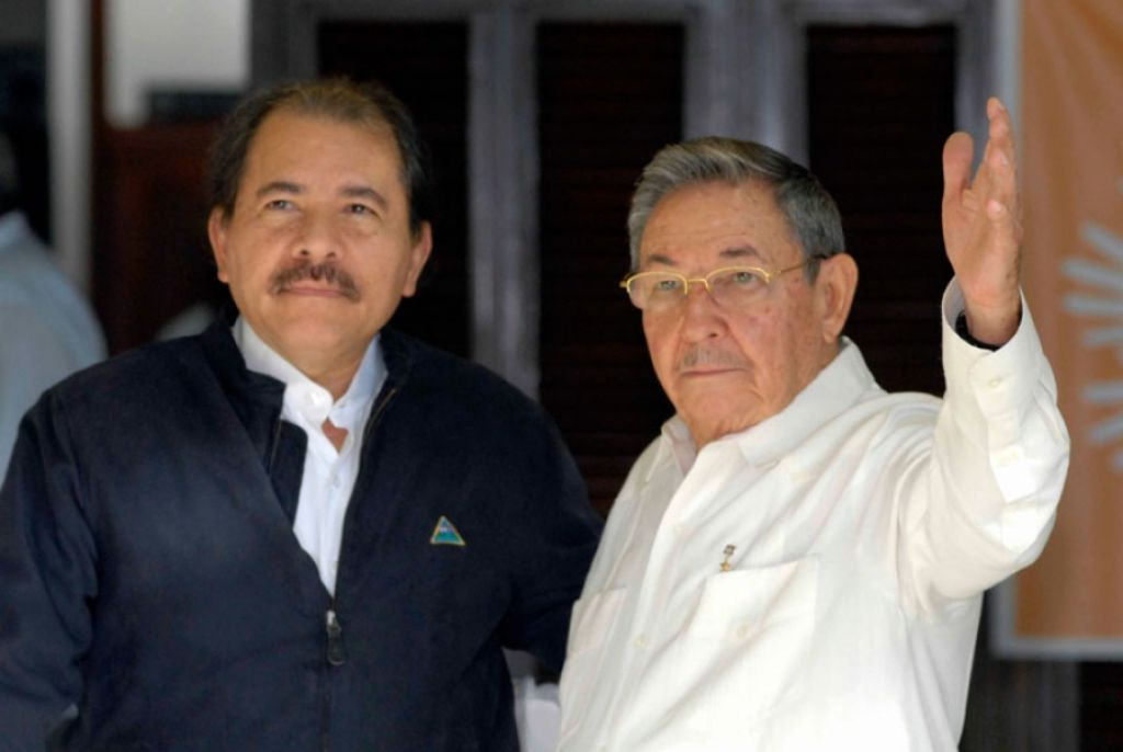Archives photo of Daniel Ortega (left) and Raul Castro (right(