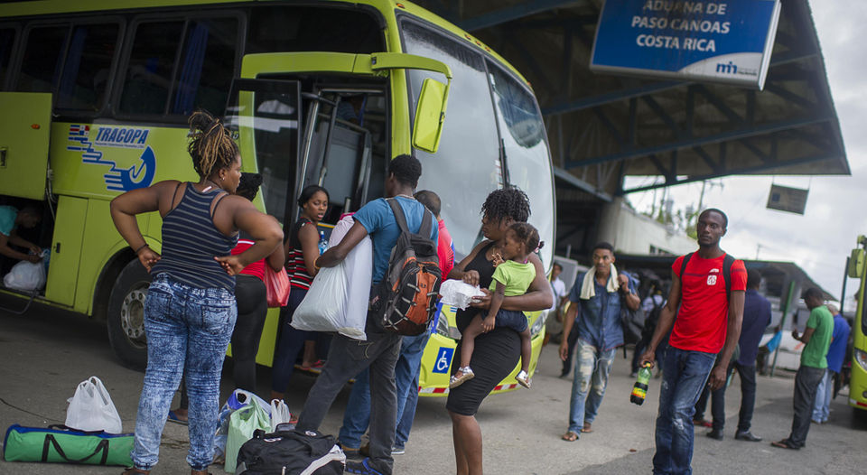 Migrants at the Paso Canos border with Panama with transit visa board a bus to the northen border with Nicaragua.