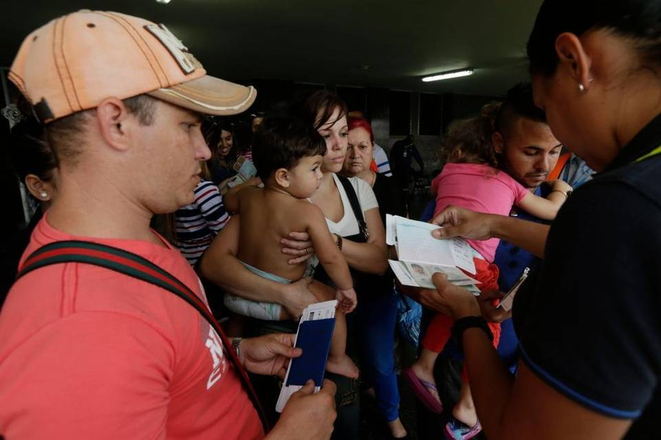 A migration officer checks the documents of Cuban migrants before they board a chartered flight in Panama City in May. U.S. officials are urging Latin American governments to stem the tide of Cubans who travel through South and Central America to reach the United States. Arnulfo Franco AP Read more here: http://www.heraldonline.com/news/nation-world/world/article98110717.html#storylink=cpy