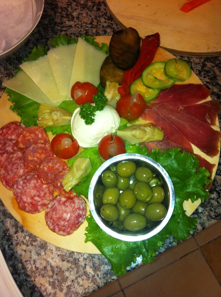 A colorful antipasto platter from Sapore Trattoria, features delicious Italian meats, cheeses and olives.