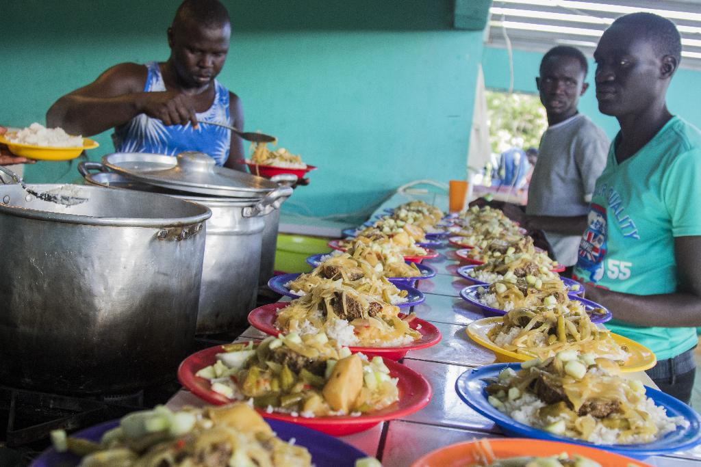 After waiting for two hours for the Haitians to finish using the kitchen, the group of Africans serve a dish of food in a very orderly fashion. The dish from Senegal, called Farci, contains onion, garlic, pepper, rice, meat and egg.