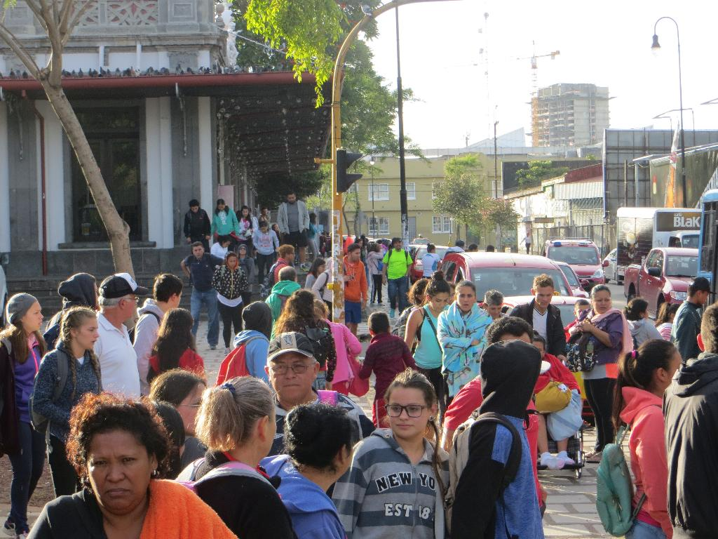 Every half hour, the Cartago Express off-loads hundreds of passengers returning from the Basilica, at the Atlantic Train Station in Downtown San José.