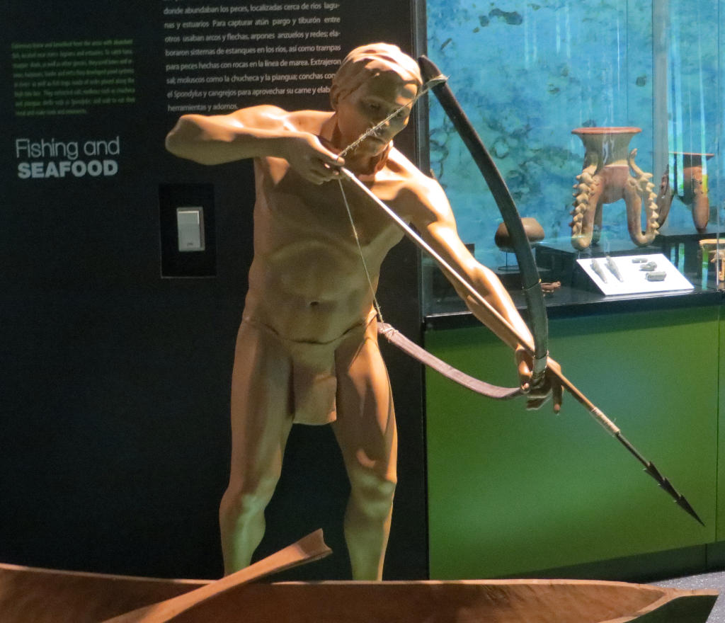 A tribesman fishing with bow and arrow.