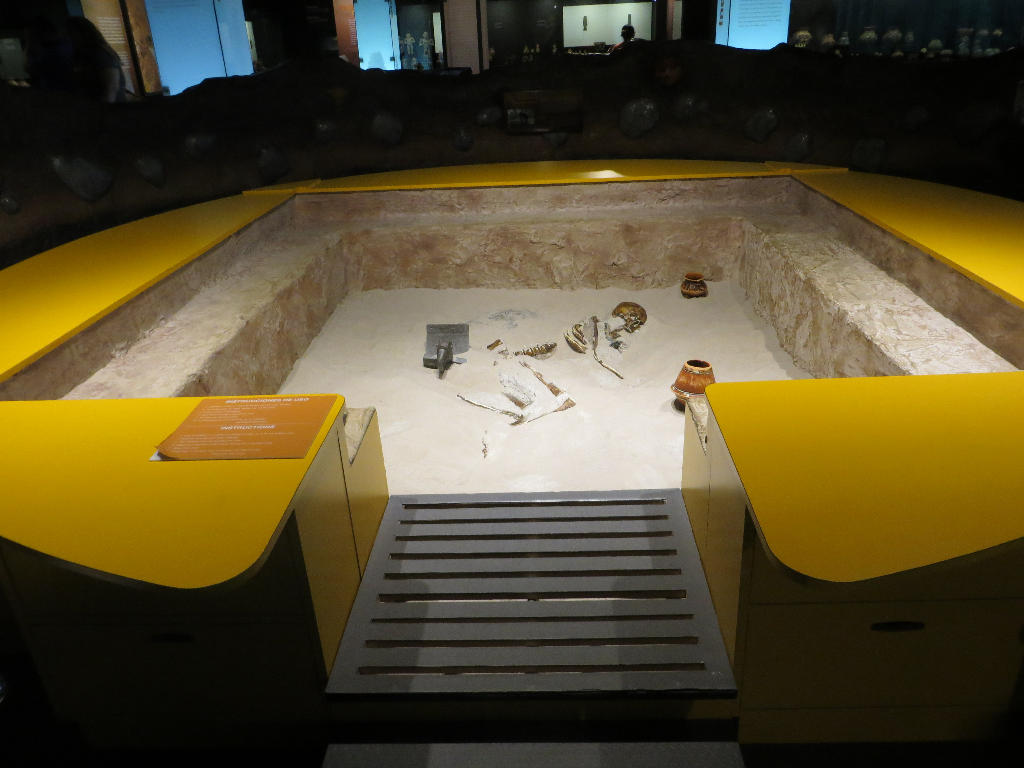 """- A sandbox . . . . really. Children are introduced to archaeology by """"discovering"""" artifacts, and a skeleton."""