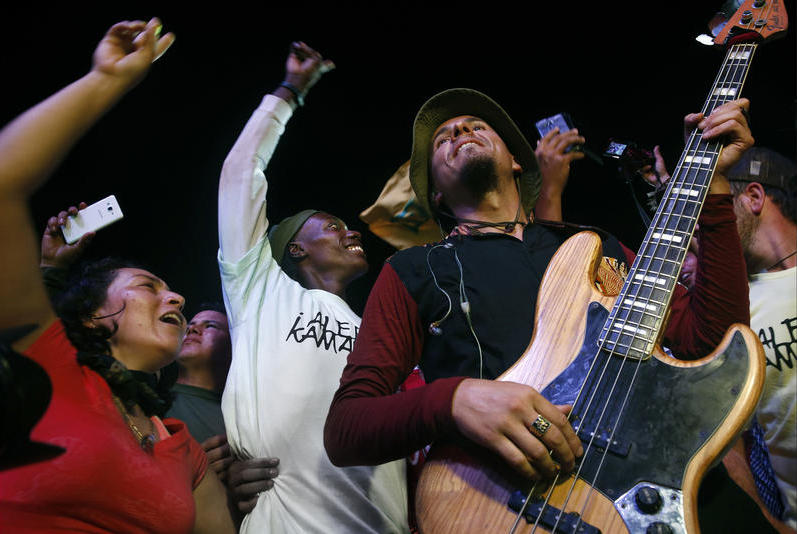 FARC members with guitarist Pablo Araoz of the Bogota reggae group Alerta Kamarad on the first night of the conference. It was the first concert some FARC members and residents had ever experienced.