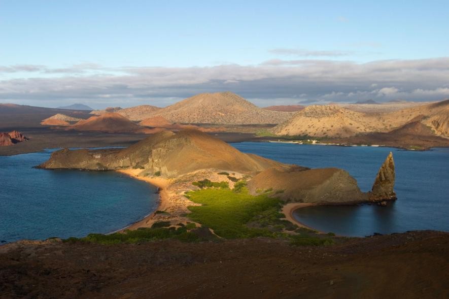 Morning light shines on the volcanic landscape of Bartolome Island in the Galápagos. The Presidents of Ecuador, Costa Rica, and Colombia convened on the islands to announce new protection of marine waters on Friday. Photograph by Ralph Lee Hopkins, National Geographic Creative