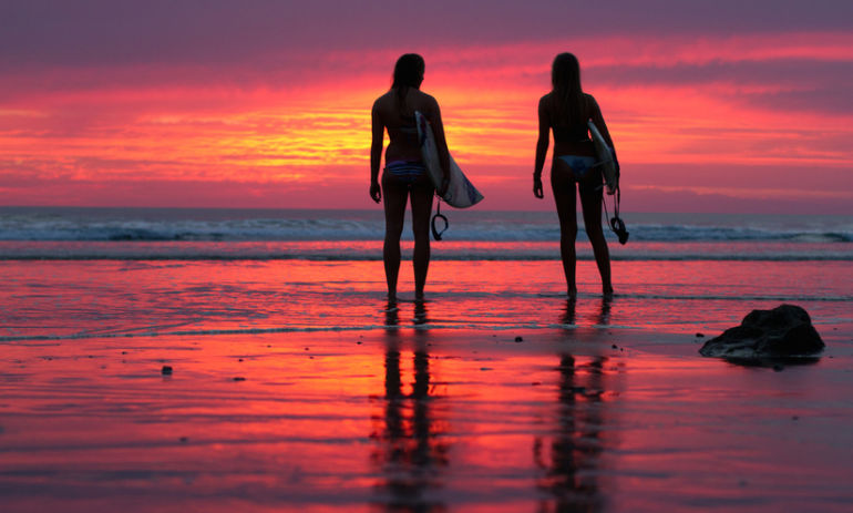 Sunset surfers in Costa Rica