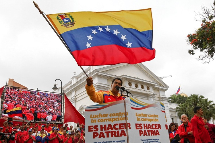 Venezuelan President Nicolas Maduro speaks during a demonstration against corruption in Caracas, Venezuela