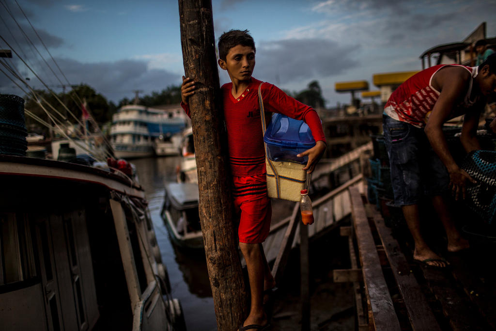 Boys selling staples in Santana, near the city of Macapá. The local government lacks the means to fight the growing threat of piracy. Credit Dado Galdieri for The New York Times