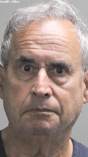 Bruce Levy, 69, formerly of Boca Raton, was extradited from Costa Rica to face federal charges he was growing 984 marijuana plants in a Lake Worth storefront in 2011. He has pleaded not guilty to the charges. (Sun Sentinel / Broward Sheriff's Office Handout)