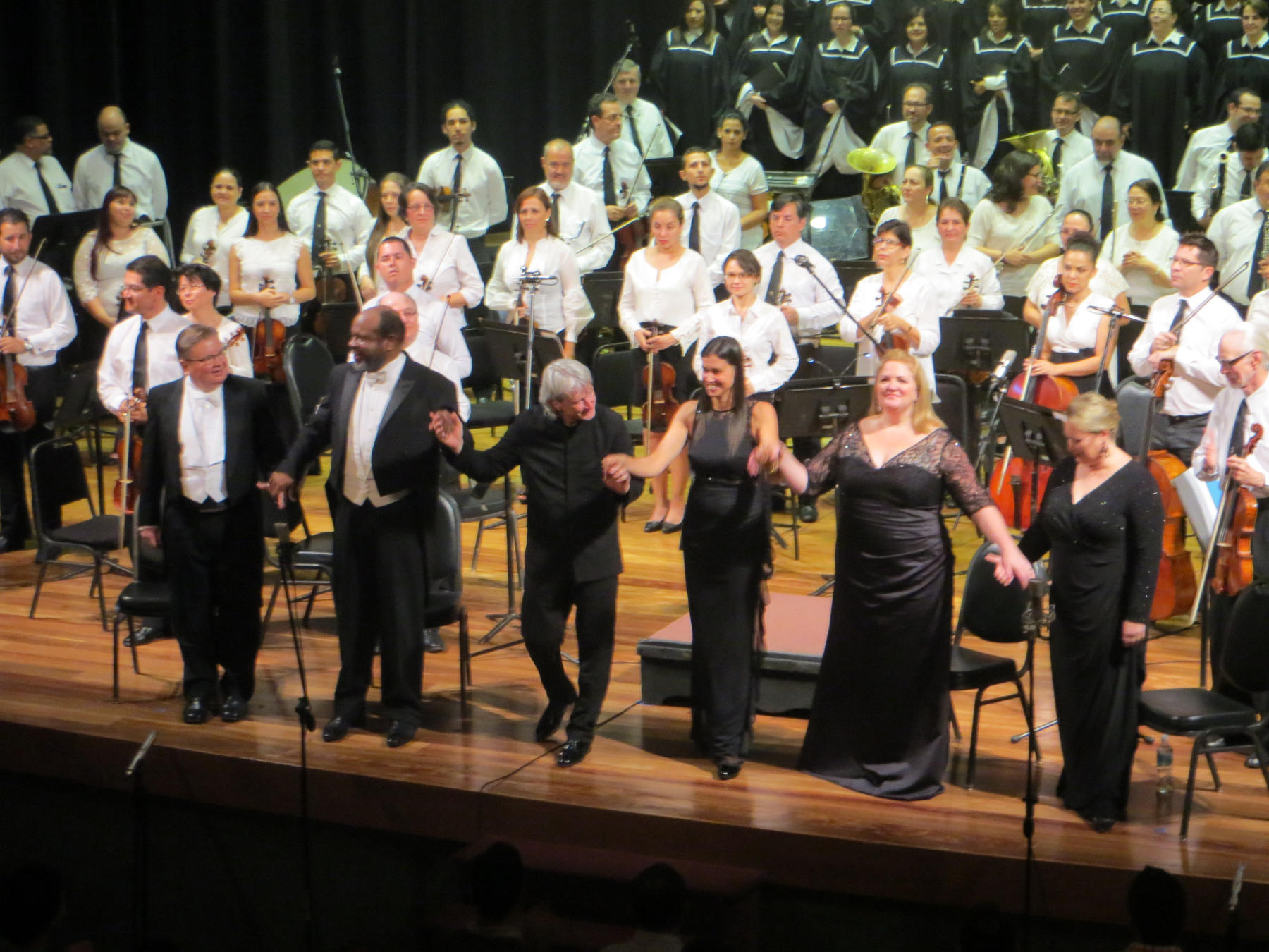 Soloists and conductor take a bow after Beethoven's 9th Symphony.
