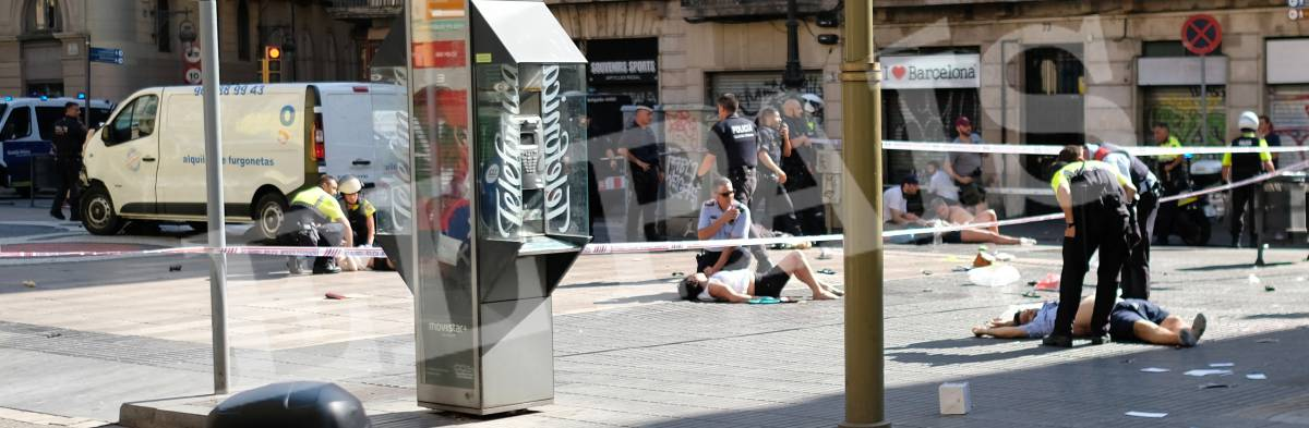 a white van drove into a busy tourist district down the pedestrian concourse in las ramblas a popular area in the heart of barcelona and continued